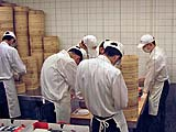 Kitchen staff making dumplings at Din Tai Fung