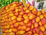 Mangoes at the neighborhood fruit stand