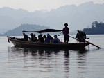 Longtail boat departing the pier on the lake at Khao Sok park