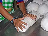 Forming kneaded dough into a cylinder