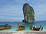 Longtail boats and famous karst from the beach on Ko Poda