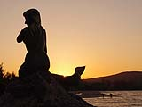 Mermaid in silhouette at sunset on Samila Beach, Songkhla