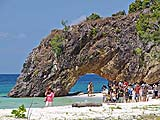 Tourists posing at the arch on Koh Kai, Tarutao Park